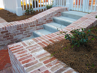 Entryway with Brick Walls & Concrete Steps with Broken Tile Inlay - Baytowne Wharf, Miramar, FL